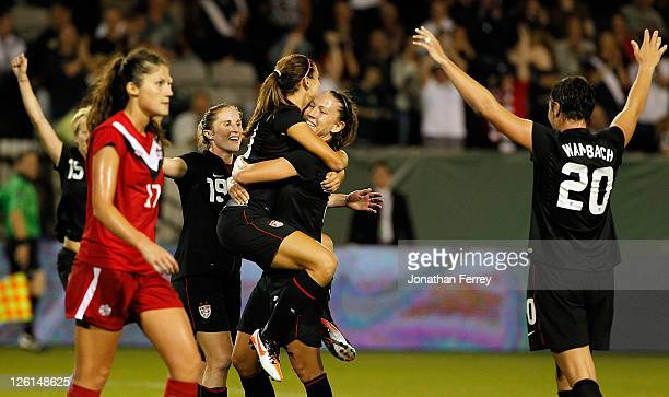 Alex Morgan of the United States is hoisted by Lauren Cheney after scoing a goal againstof Canada on September 22 2011 at JeldWen Field in Portland...