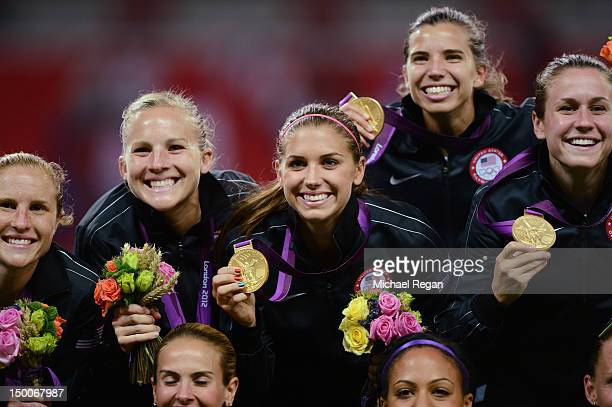 Alex Morgan of the United States kisses the the gold medal after defeating Japan by a score of 21 to win the Women's Football gold medal match on Day...