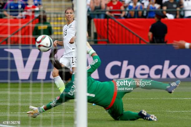 Alex Morgan of the United States scores her first goal against goalkeeper Stefany Castano of Colombia in the second half in the FIFA Women's World...