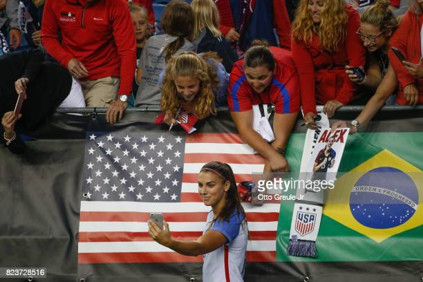 Alex Morgan of the United States shoots a selfie with fans following the match against Australia during the 2017 Tournament of Nations at CenturyLink...