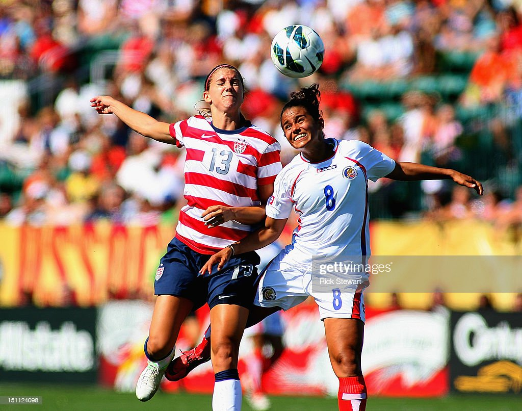 Alex Morgan #13 of the United States Womens National Team attacks against Daniela Cruz #8 of Costa Rica during their friendly match at Sahlen's Stadium on September 1, 2012 in Rochester, New York. The US won 8-0.