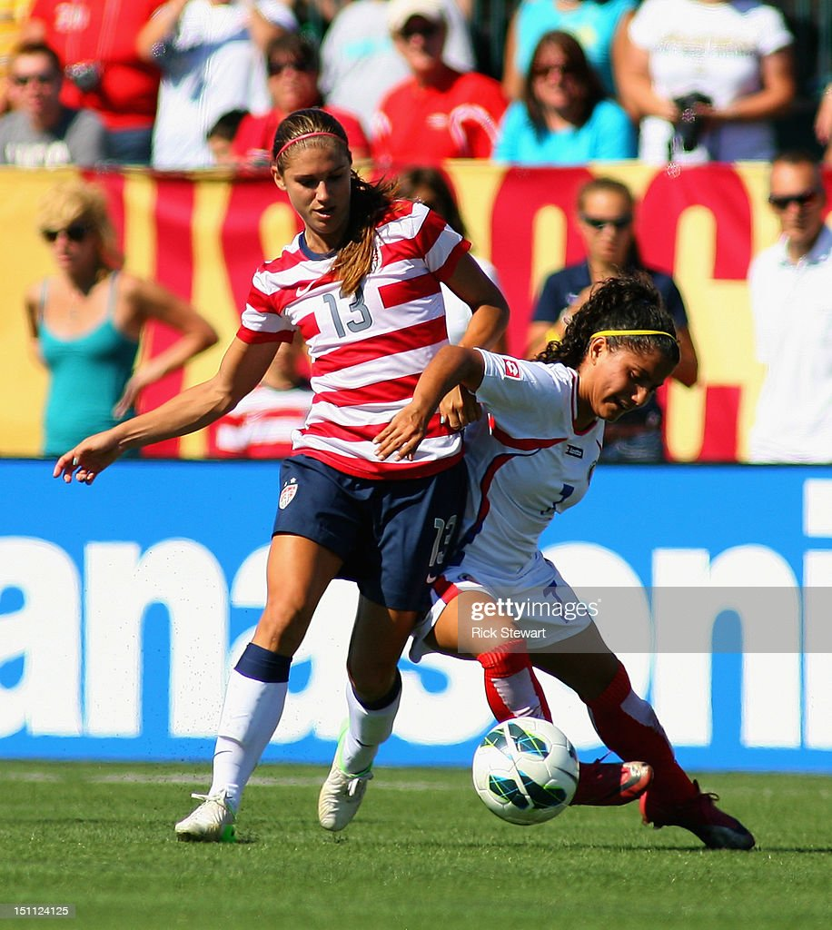 Alex Morgan #13 of the United States Womens National Team attacks against Mariela Campos #7 of Costa Rica during their friendly match at Sahlen's Stadium on September 1, 2012 in Rochester, New York. The US won 8-0.