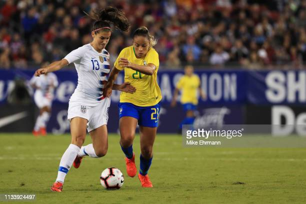 Alex Morgan of the USA and Mônica of Brazil fight for control of the ball in the first half during the She Believes Cup at Raymond James Stadium on...