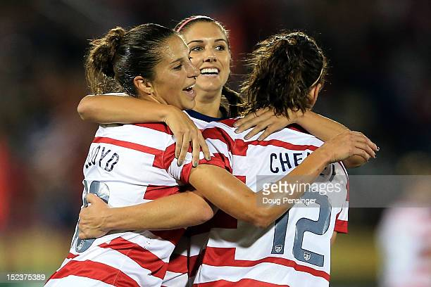 Alex Morgan of the USA celebrates her goal in the 42nd minute against Australia with Carli Lloyd of the USA and Lauren Cheney of the USA at Dick's...