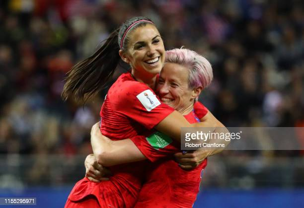 Alex Morgan of the USA celebrates with teammate Megan Rapinoe after scoring her team's twelfth goal during the 2019 FIFA Women's World Cup France...