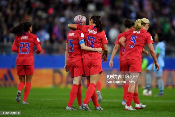 Alex Morgan of the USA celebrates with teammate Megan Rapinoe after scoring her team's tenth goal during the 2019 FIFA Women's World Cup France group...