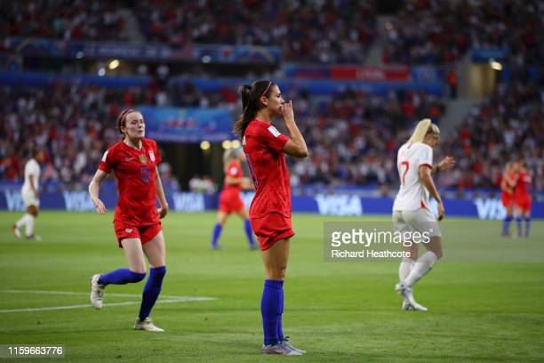Alex Morgan of the USA celebrates with teammate Rose Lavelle after scoring her team's second goal during the 2019 FIFA Women's World Cup France Semi...