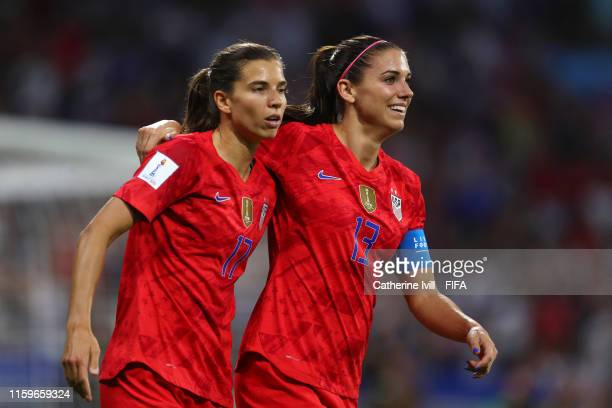 Alex Morgan of the USA celebrates with teammate Tobin Heath after scoring her team's second goal during the 2019 FIFA Women's World Cup France Semi...