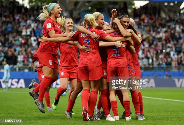 Alex Morgan of the USA celebrates with teammates after scoring her team's first goal during the 2019 FIFA Women's World Cup France group F match...