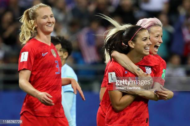 Alex Morgan of the USA celebrates with teammates after scoring her team's fifth goal during the 2019 FIFA Women's World Cup France group F match...