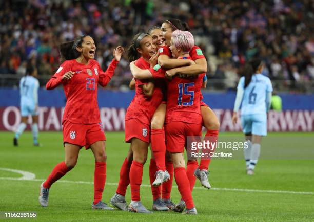 Alex Morgan of the USA celebrates with teammates after scoring her team's twelfth goal during the 2019 FIFA Women's World Cup France group F match...