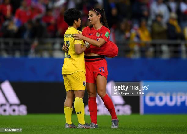 Alex Morgan of the USA consoles Sukanya Chor Charoenying of Thailand after USA's victory in the 2019 FIFA Women's World Cup France group F match...