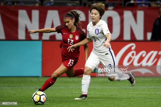 Alex Morgan of the USA fights for a ball with Damyeong Shin of the Korea Republic at the MercedesBenz Superdome on October 19 2017 in New Orleans...
