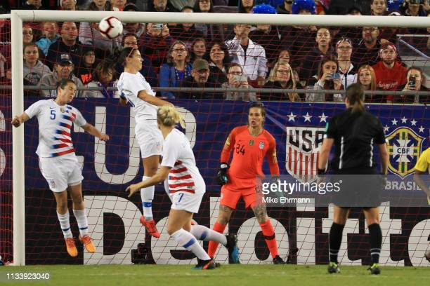 Alex Morgan of the USA heads the ball out in the first half against Brazil during the She Believes Cup at Raymond James Stadium on March 05 2019 in...