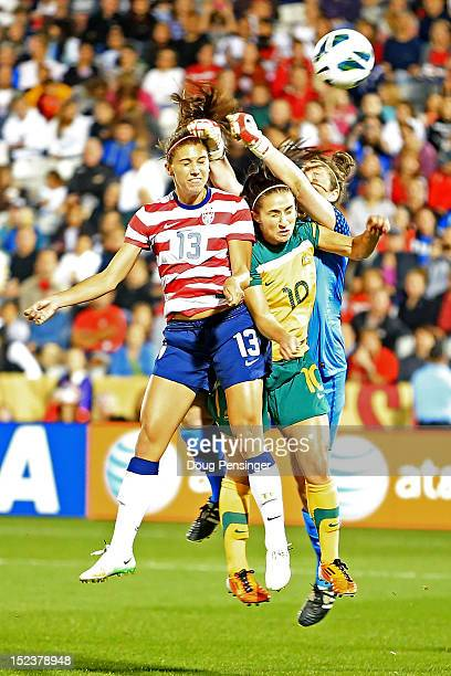 Alex Morgan of the USA heads the ball past Servet Uzunlar of Australia and goalkeeper Brianna Davey of Australia for a goal in the 63rd minute at...