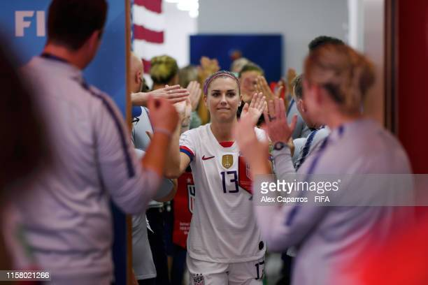 Alex Morgan of the USA high fives the USA team as he walks down the tunnel prior to the 2019 FIFA Women's World Cup France Round Of 16 match between...