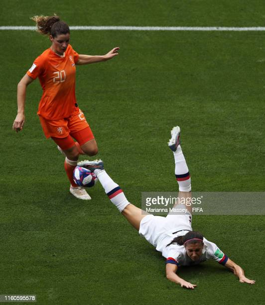 Alex Morgan of the USA is challenged by Dominique Bloodworth of the Netherlands during the 2019 FIFA Women's World Cup France Final match between The...