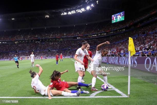 Alex Morgan of the USA is challenged by Lucy Bronze Jade Moore and Nikita Parris of England during the 2019 FIFA Women's World Cup France Semi Final...