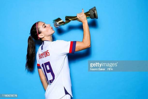 Alex Morgan of the USA poses with the Women's World Cup trophy after the 2019 FIFA Women's World Cup France Final match between The United State of...