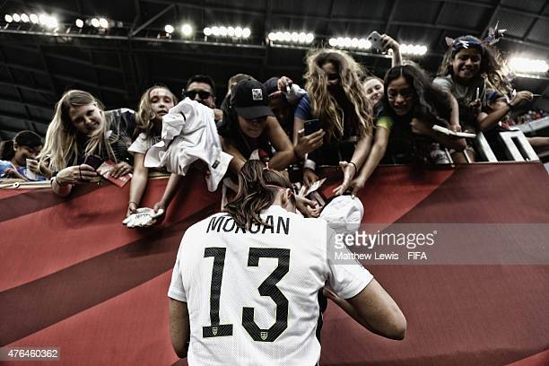 Alex Morgan of the USA signs autographs for fans after the FIFA Women's World Cup 2015 Group D match between USA and Australia at Winnipeg Stadium on...