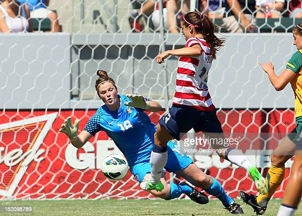 Alex Morgan of the USA tries to play the ball past goalkeeper Brianna Davey of Australia in the second half during the international friendly match...
