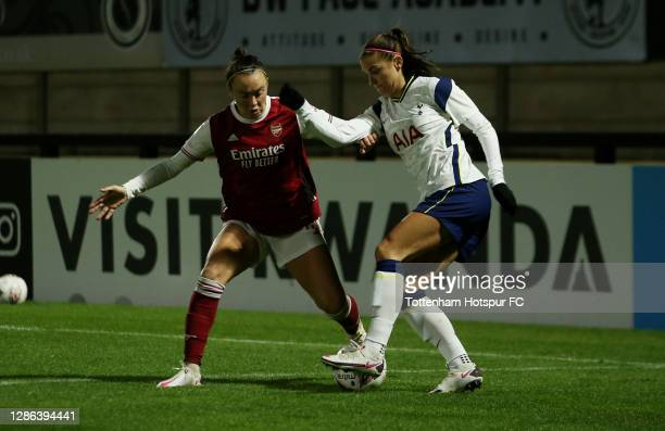 Alex Morgan of Tottenham Hotspur and Katie McCabe of Arsenal battle for the ball during the FA Women's Continental League Cup match between Arsenal...