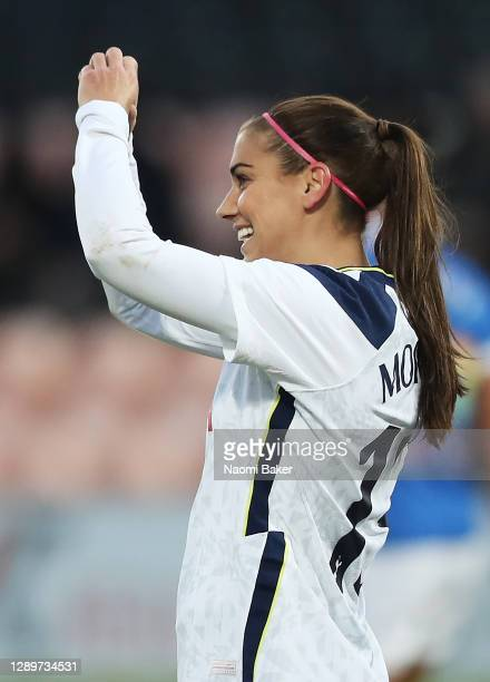 Alex Morgan of Tottenham Hotspur celebrates after scoring her team's third goal as she makes a love heart with her hands towards her husband Servando...