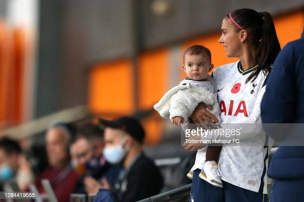 Alex Morgan of Tottenham Hotspur stands with her daughter following the Barclays FA Women's Super League match between Tottenham Hotspur Women and...