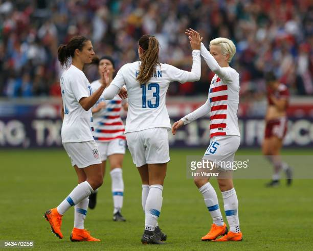 Alex Morgan of United States and Carli Lloyd congratulate Megan Rapinoe after a goal in the second half against the Mexico at BBVA Compass Stadium on...