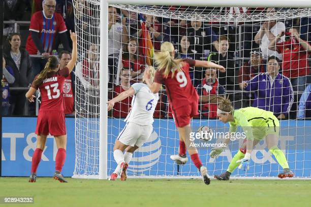 Alex Morgan of United States celebrates as Karen Bardsley of England can not handle the ball as Megan Rapinoe of United States scores a goal during...