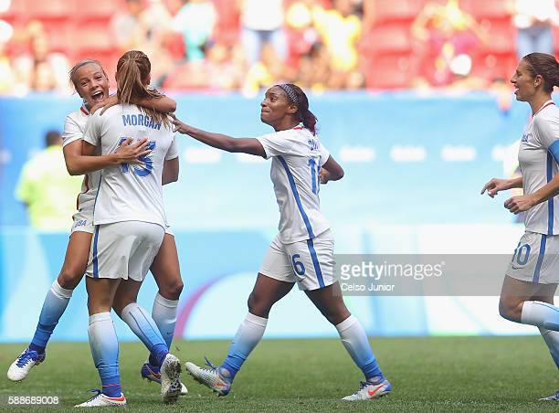 Alex Morgan of United States celebrates her goal to tie the game with teammates Mallory Pugh Crystal Dunn and Carli Lloyd in the second half against...