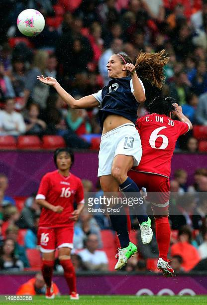 Alex Morgan of United States clashes with Choe Un Ju of DPR Korea during the Women's Football first round Group G match between the United States and...