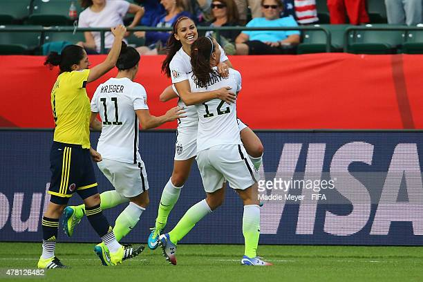 Alex Morgan of United States of America celebrates with Alex Krieger and Lauren Holiday after scoring a goal during the FIFA Women's World Cup Canada...