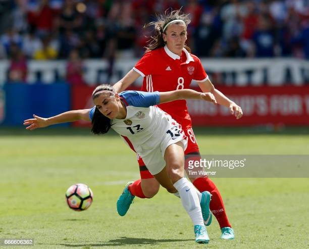 Alex Morgan of US is fouled by Daria Makarenko of Russia in the second half during the International Friendly soccer match at BBVA Compass Stadium on...