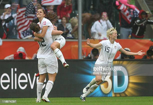 Alex Morgan of USA celebrates her team's 3rd goal with her team mates Lauren Cheney and Kelly O Hara during the FIFA Women's World Cup 2011 Semi...