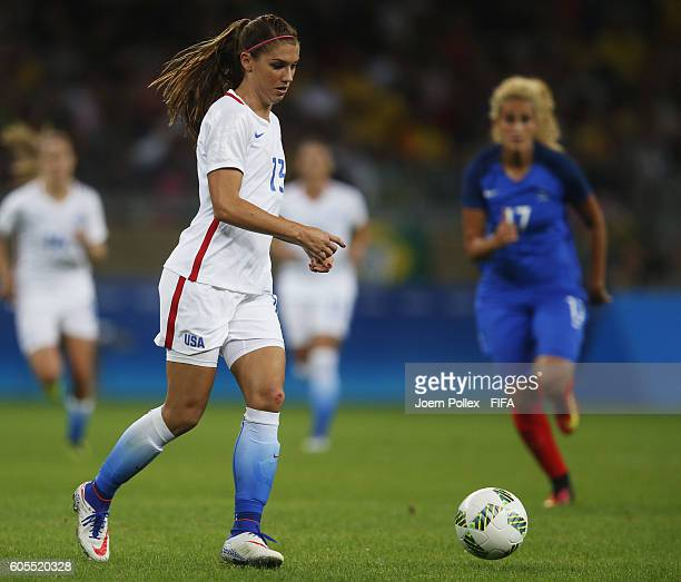 Alex Morgan of USA controls the ball during the Women's Group G match between USA and France on Day 1 of the Rio2016 Olympic Games at Mineirao...