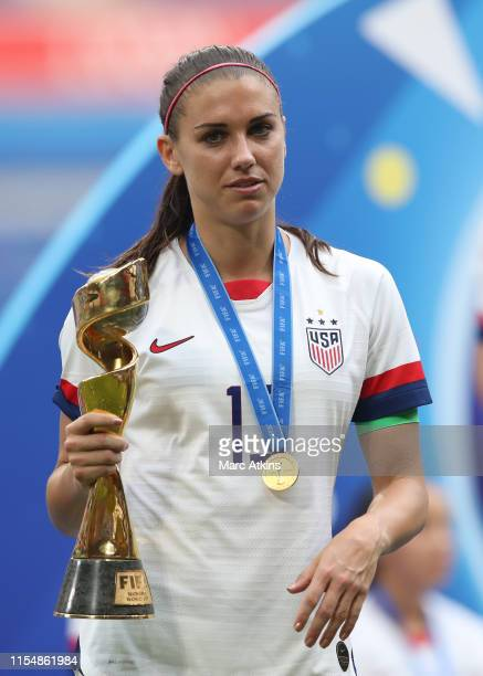 Alex Morgan of USA holds the trophy during the 2019 FIFA Women's World Cup France Final match between The United States of America and The...