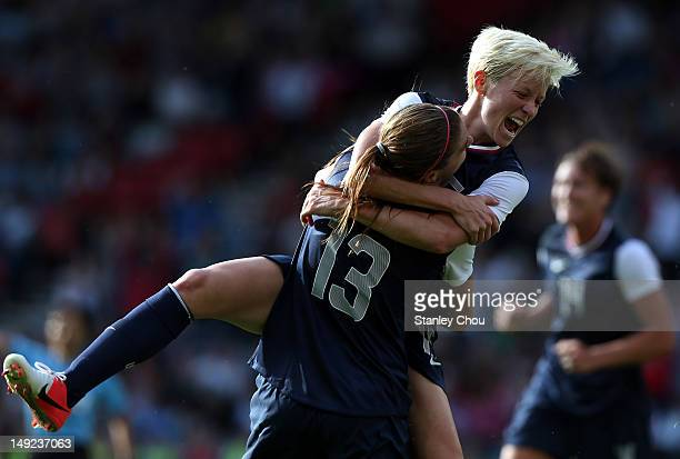 Alex Morgan of USA is congratulated by Megan Rapinoe after scoring during the Women's Football first round Group G Match of the London 2012 Olympic...
