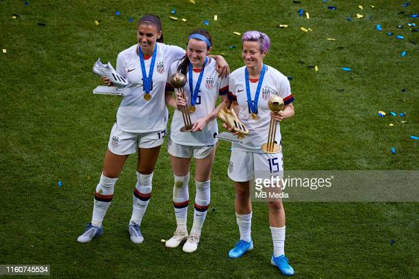 Alex Morgan of USA poses with her trophy next to her teammates Rose Lavelle and Megan Rapinoe during the 2019 FIFA Women's World Cup France Final...
