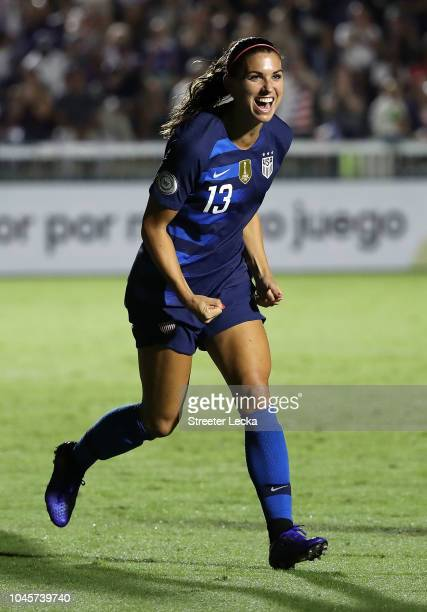 Alex Morgan of USA reacts after scoring a goal against Mexico during the Group A CONCACAF Women's Championship at WakeMed Soccer Park on October 4...