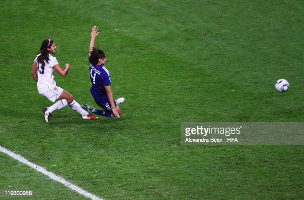 Alex Morgan of USA scores her first goal against Saki Kumagai of Japan during the FIFA Women's World Cup Final match between Japan and USA at the...