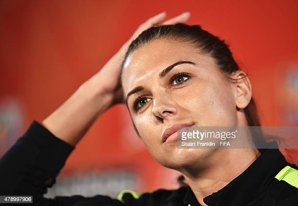 Alex Morgan of USA talks to the media during a press conference and training session prior to the FIFA Women's World Cup Semi Final match between USA...