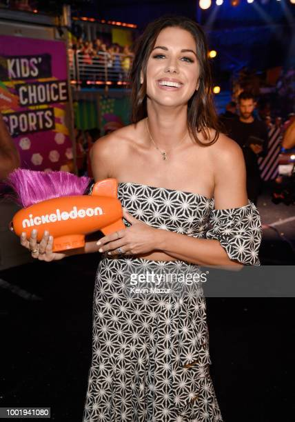 Soccer player Alex Morgan poses backstage with her 'Favorite Female Athlete' award at the Nickelodeon Kids' Choice Sports 2018 at Barker Hangar on...