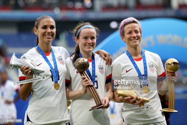 Alex Morgan Rose Lavelle and Alex Morgan pose with their tournament trophies during the 2019 FIFA Women's World Cup France Final match between The...