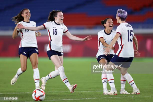 Alex Morgan, Rose Lavelle, Christen Press and Megan Rapinoe of Team United States celebrate following their team's victory in the penalty shoot out...