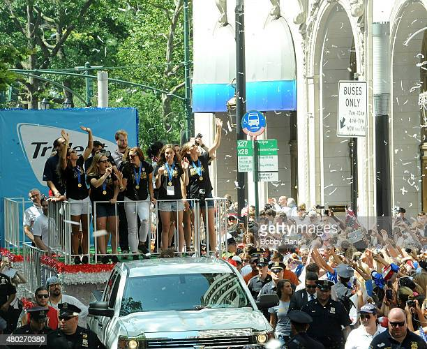 Alex Morgan Tobin Heath Lauren Holiday Amy Rodriguez and Morgan Brian during the New York City Holds Ticker Tape Parade For World Cup Champions US...