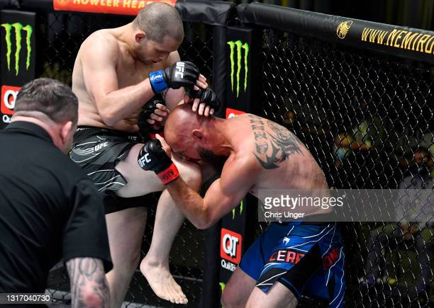 Alex Morono knees Donald 'Cowboy' Cerrone in a welterweight fight during the UFC Fight Night event at UFC APEX on May 08, 2021 in Las Vegas, Nevada.