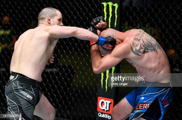 Alex Morono punches Donald 'Cowboy' Cerrone in a welterweight fight during the UFC Fight Night event at UFC APEX on May 08, 2021 in Las Vegas, Nevada.