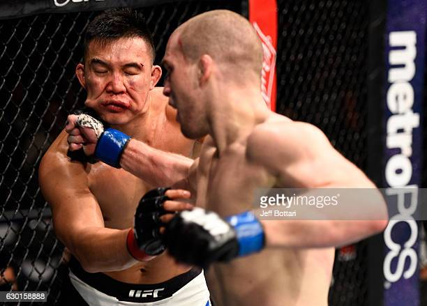 Alex Morono punches James Moontasri in their welterweight bout during the UFC Fight Night event inside the Golden 1 Center Arena on December 17, 2016...