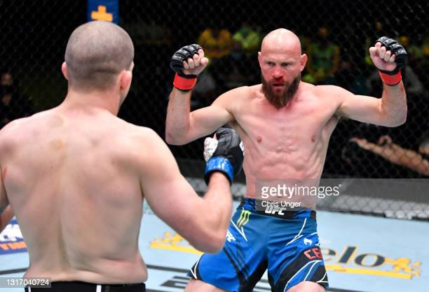 Alex Morono stuns Donald 'Cowboy' Cerrone with a punch in a welterweight fight during the UFC Fight Night event at UFC APEX on May 08, 2021 in Las...